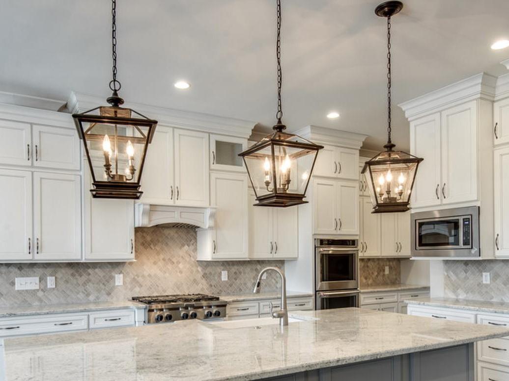 lantern style pendant lights over kitchen island